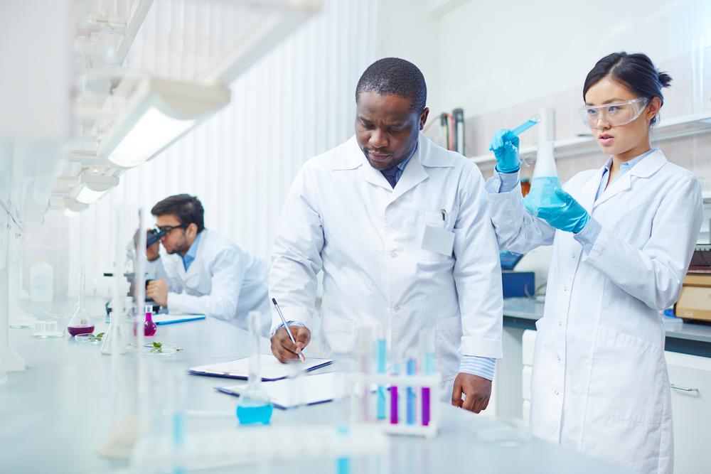 focused-female-asian-scientist-pouring-blue