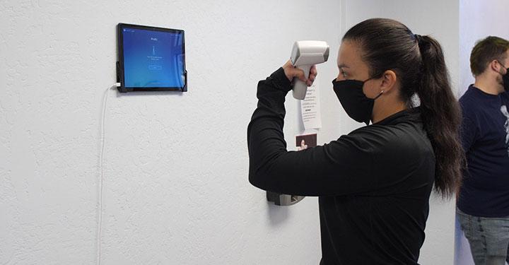Woman taking her termperature